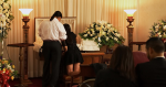 Friends Tearfully Loot Gamer's Corpse at Funeral to Pay Respects image